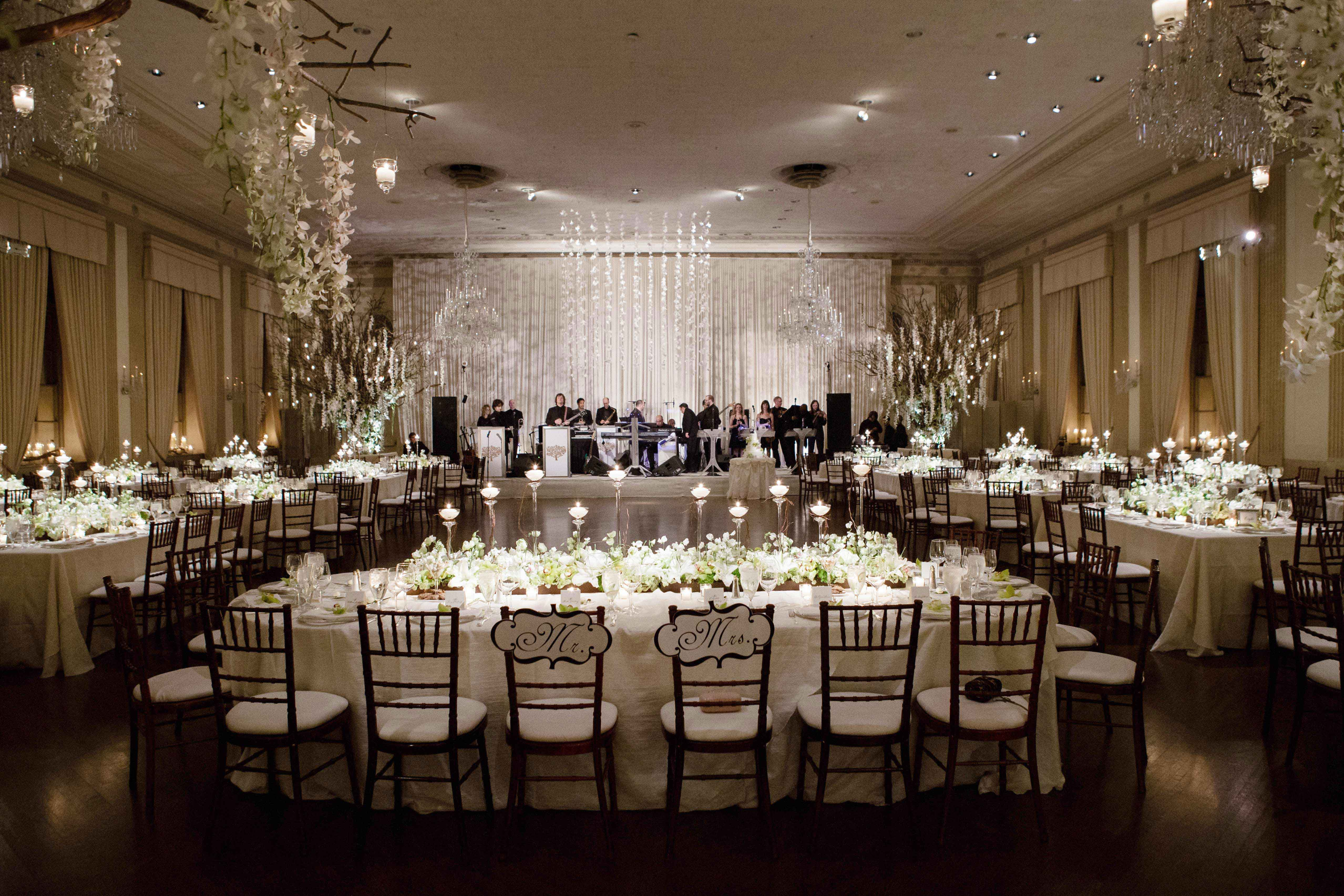 White winter wedding reception with branch decor