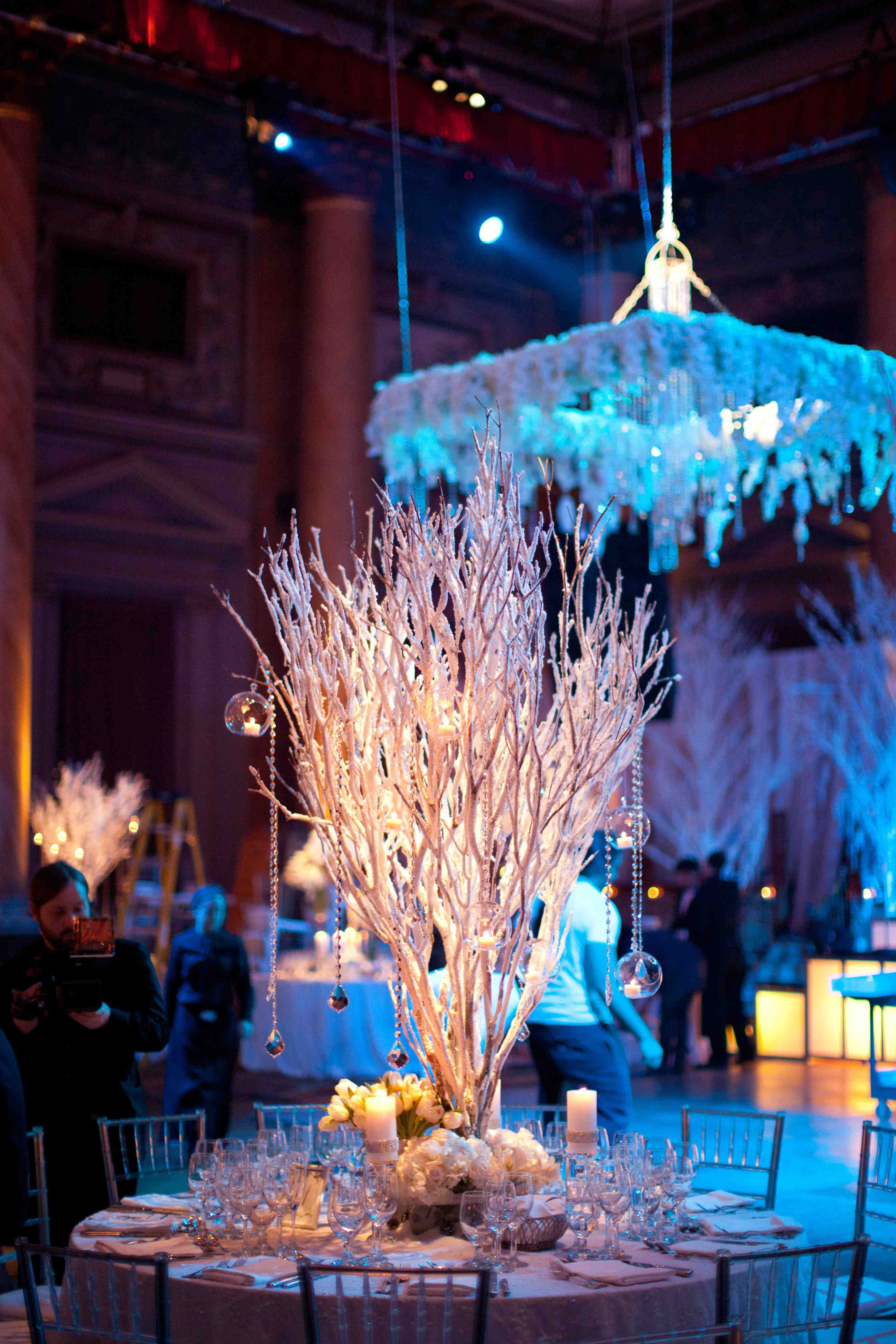 White winter wedding reception with blue lighting