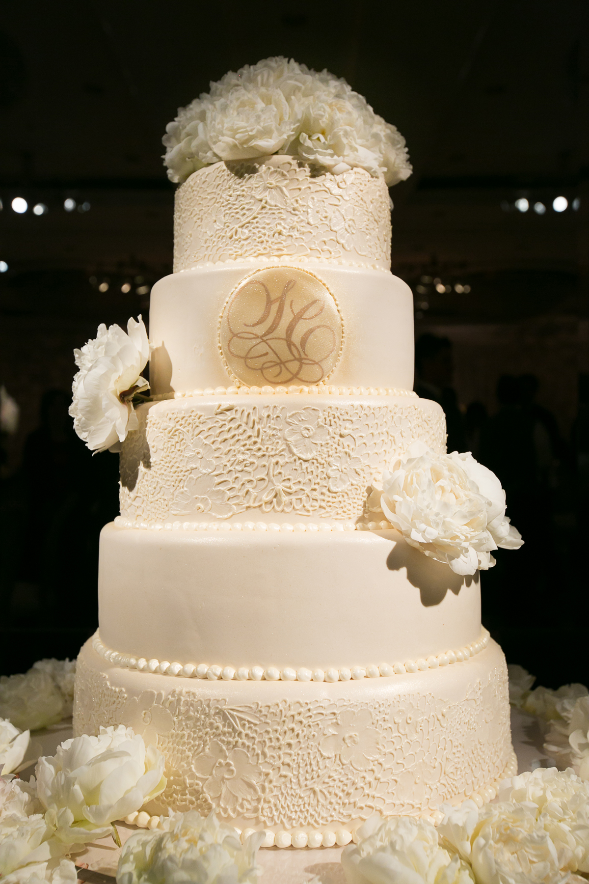 White wedding cake with lace pattern