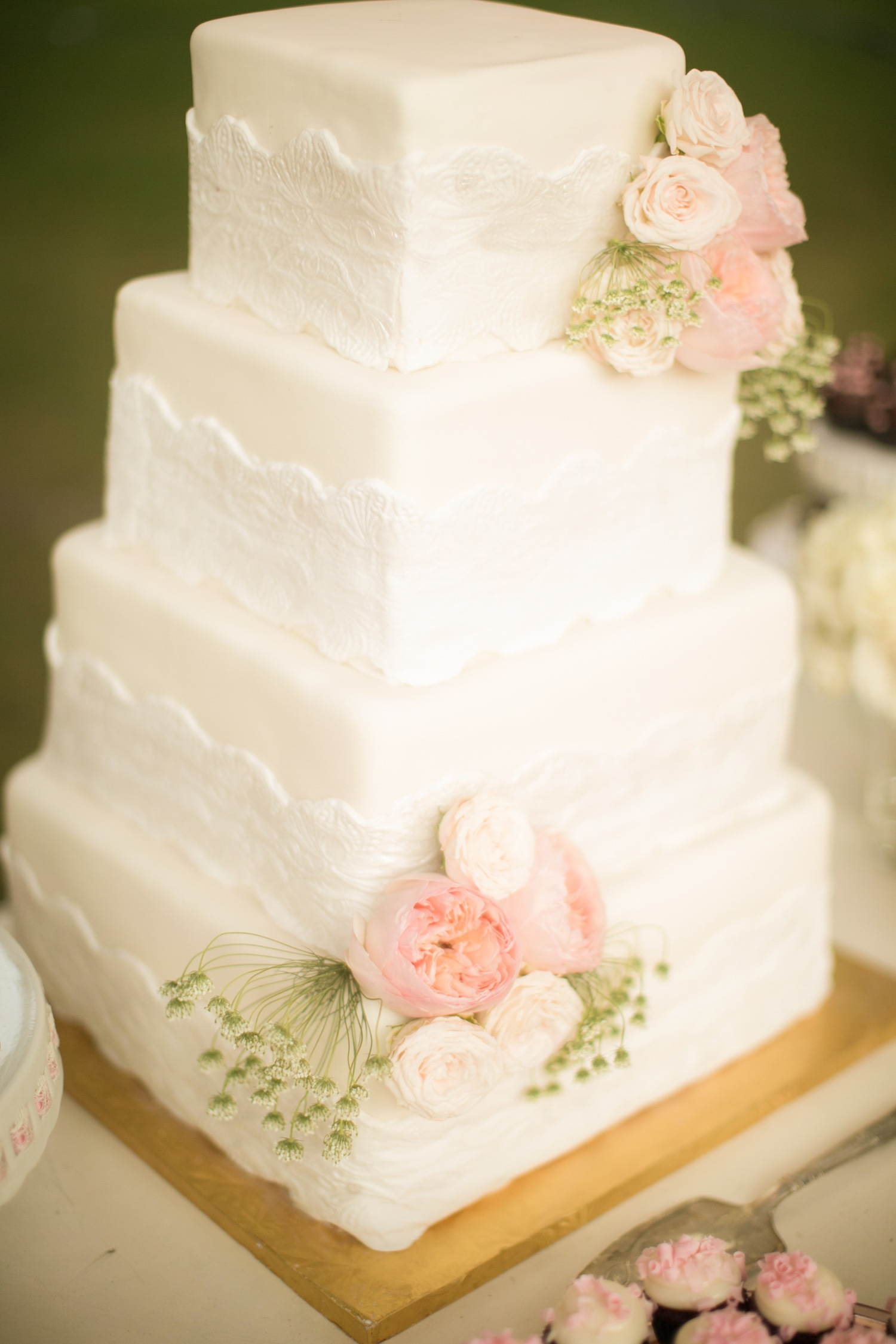 White shabby chic wedding cake with lace pattern