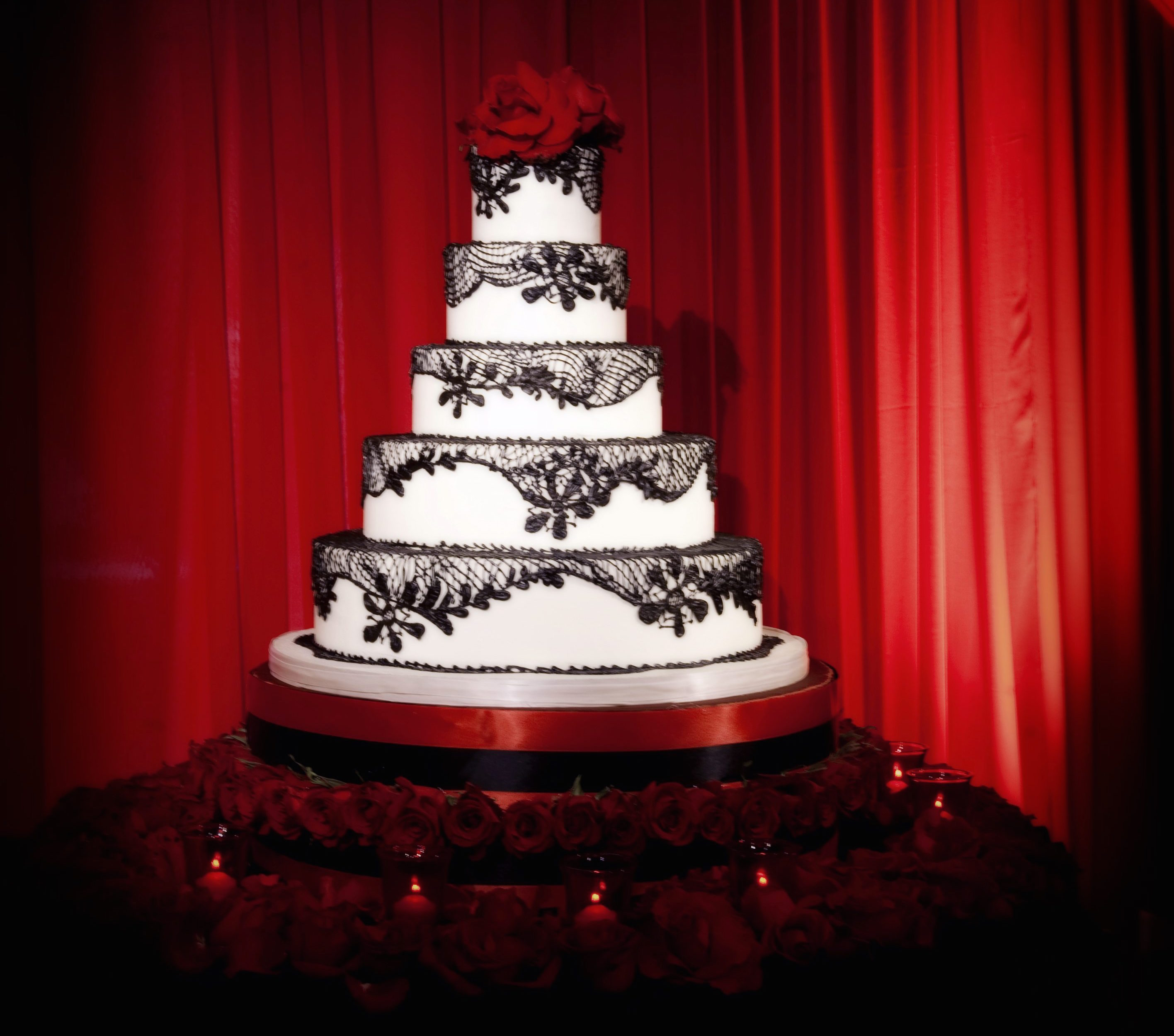 Black and white wedding cake with lace pattern
