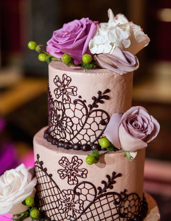 Purple wedding cake with chocolate lace pattern