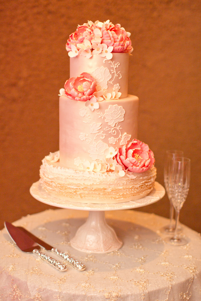 Small pink wedding cake with lace pattern