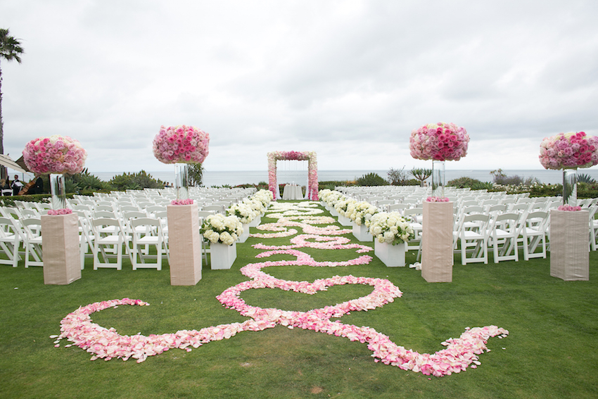 Pink swirl ombre rose petals at ceremony