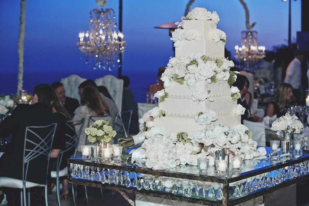 Glass cake table adorned with faceted crystal teardrops
