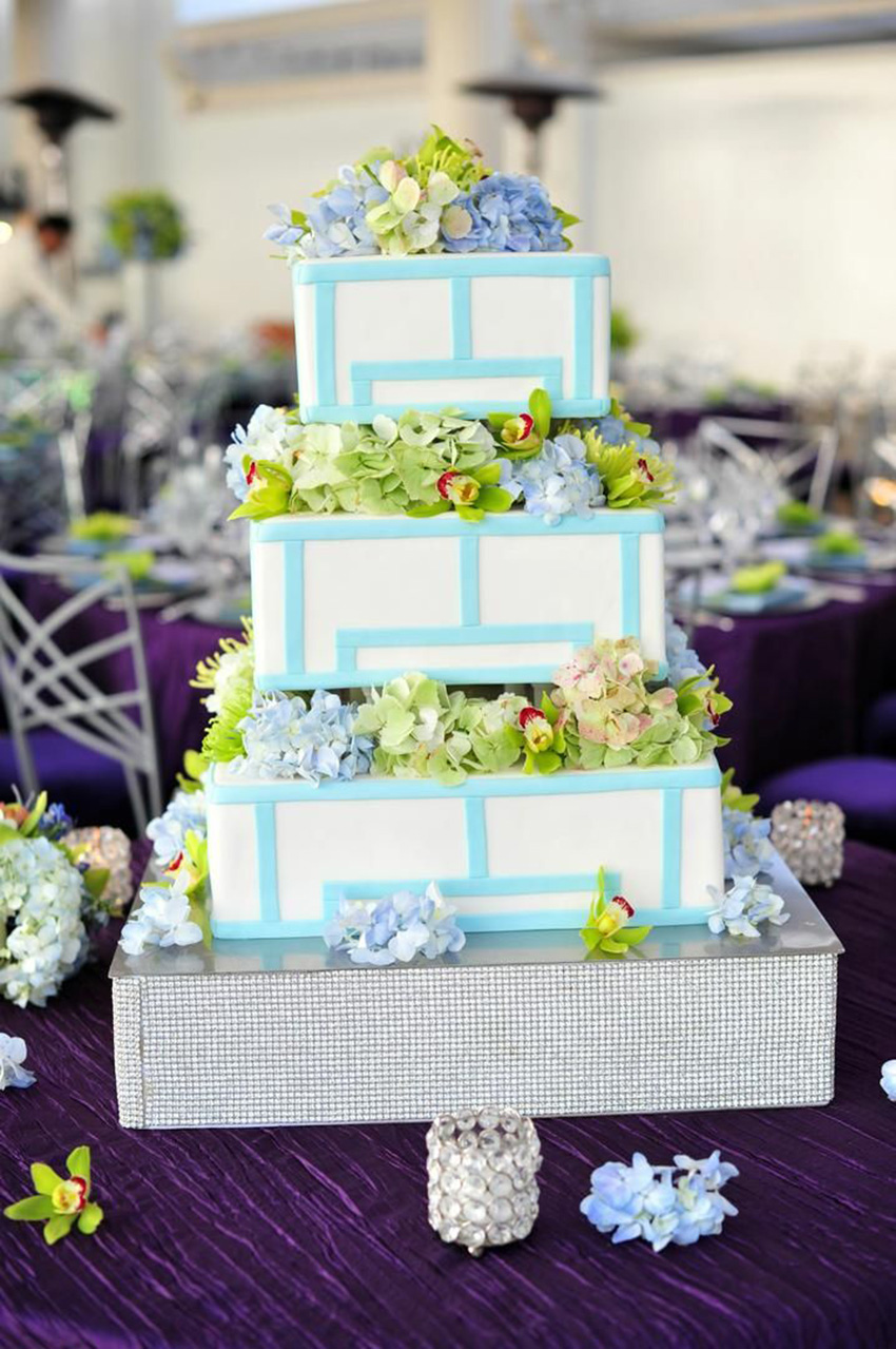 Cake platform wrapped in pave crystal ribbon