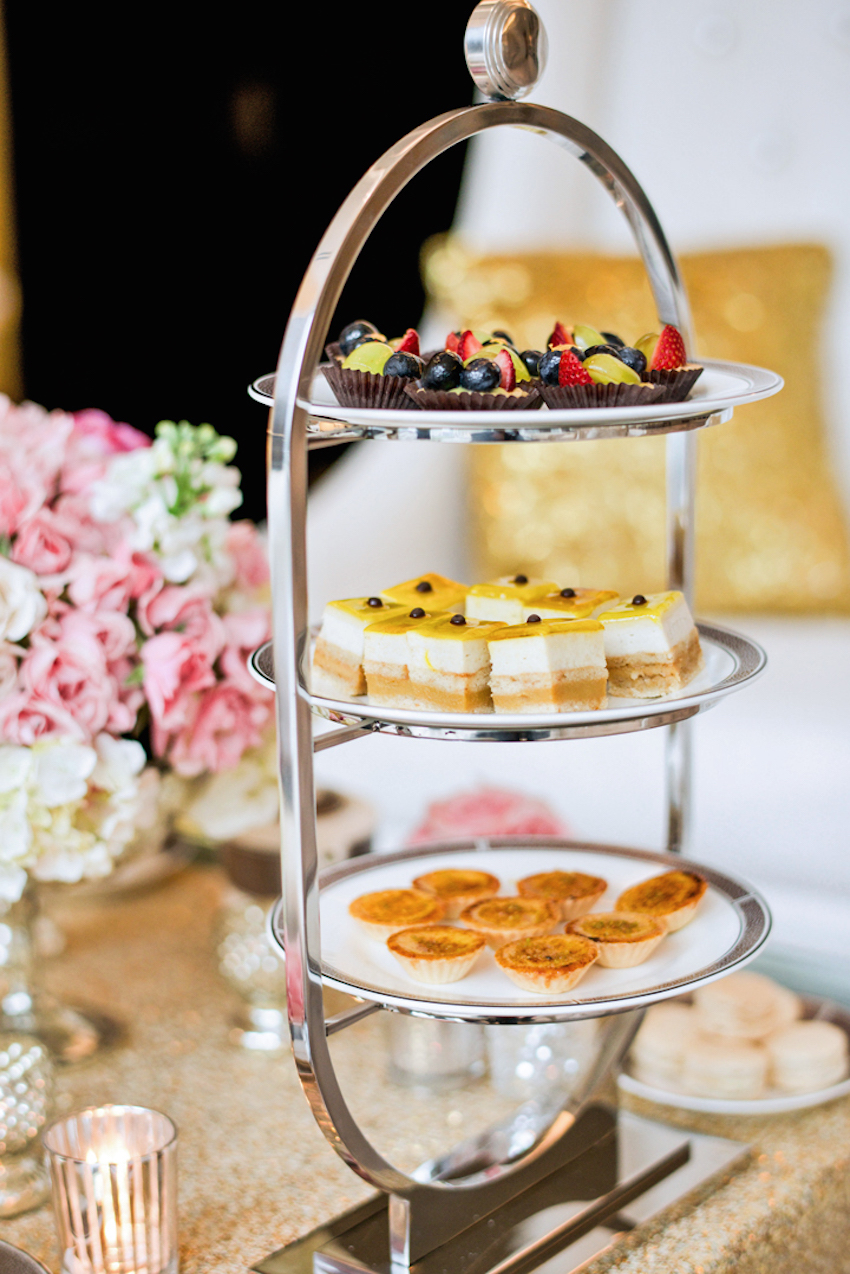Three tier tea party stand with mini desserts