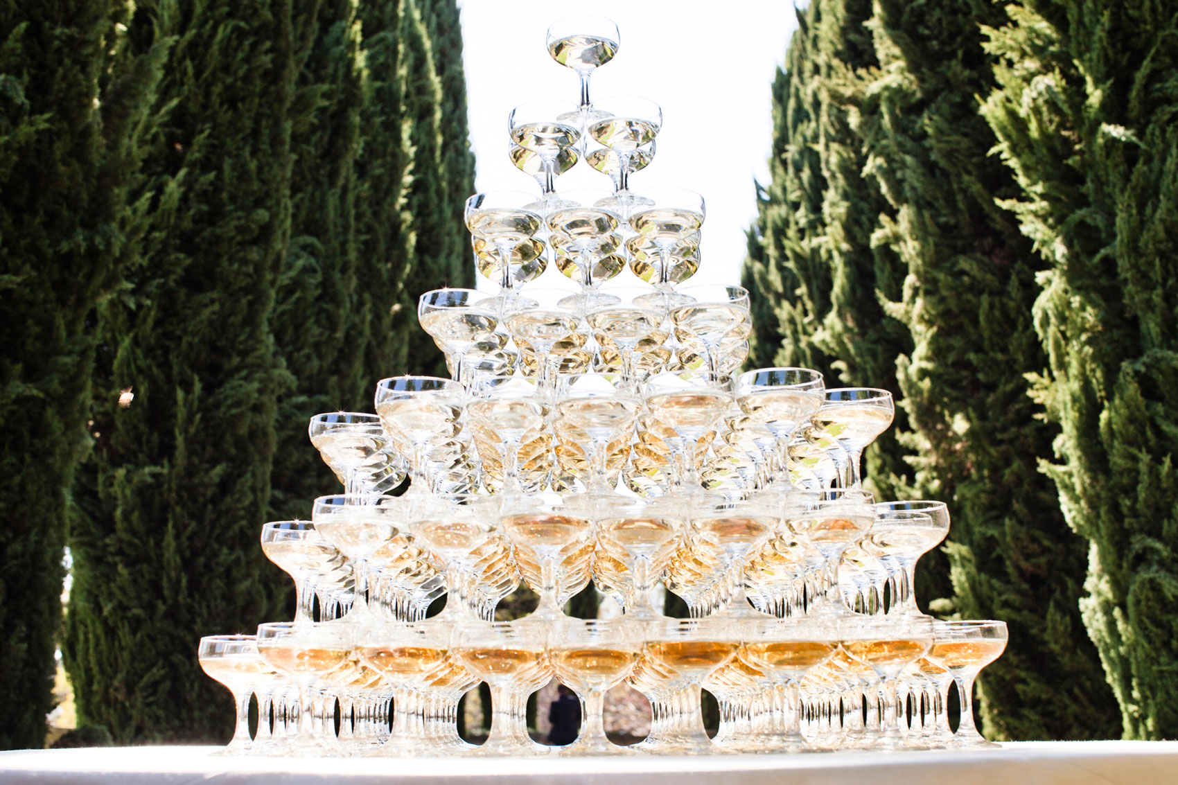 Coupe glass tower filled with Champagne