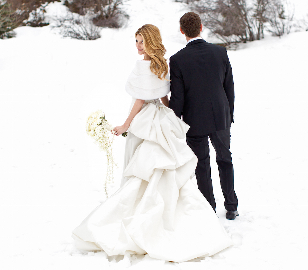 Bride and groom wedding portrait in snow