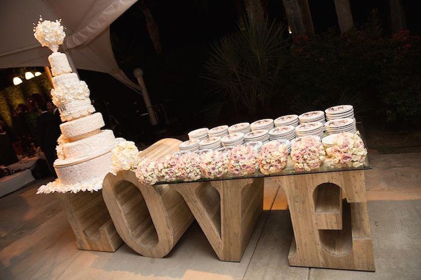 Wedding cake on wood LOVE sign