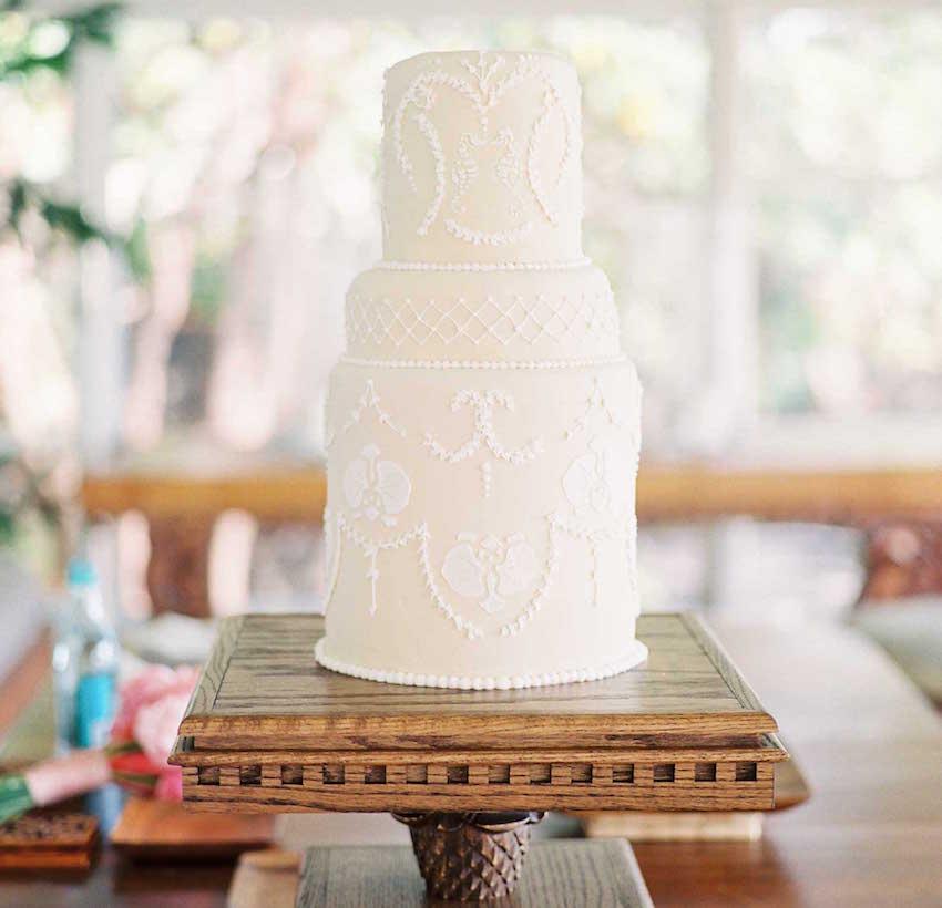 Hawaiian wedding cake on wood stand