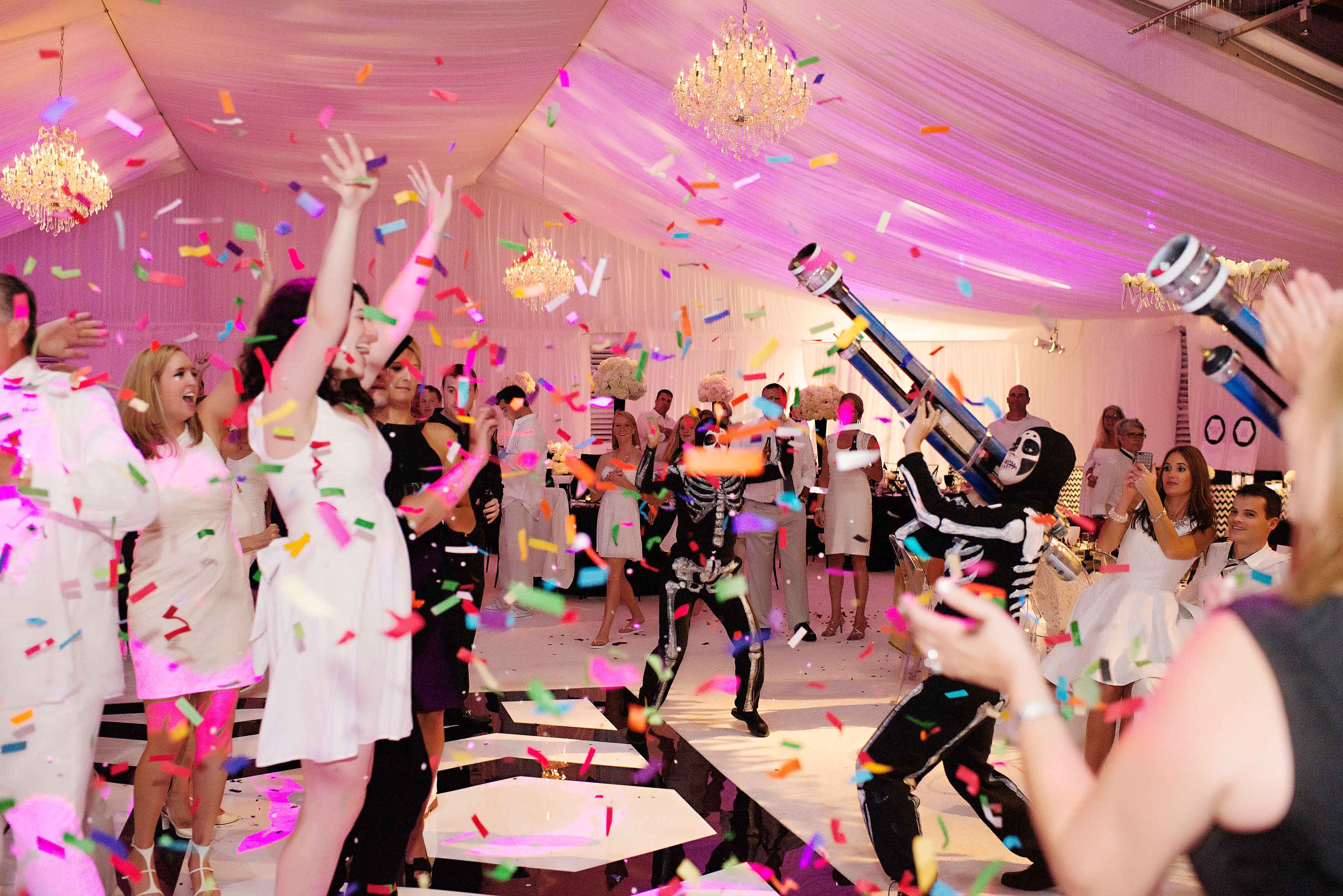 Wedding guests with confetti cannons