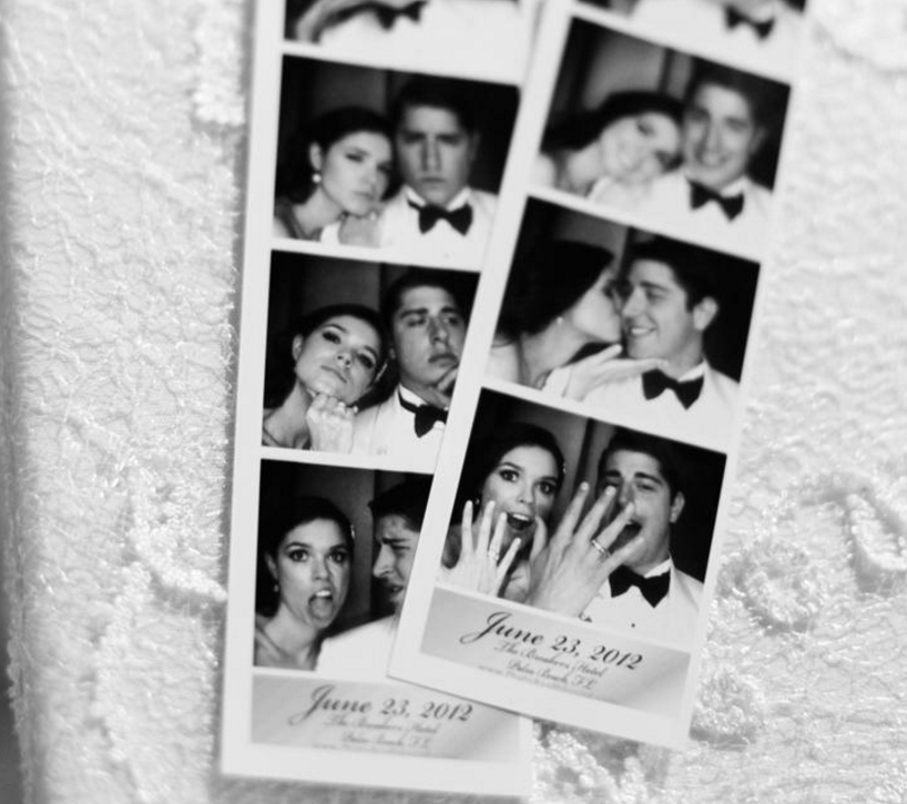 Black and white photo of wedding photo booth strips