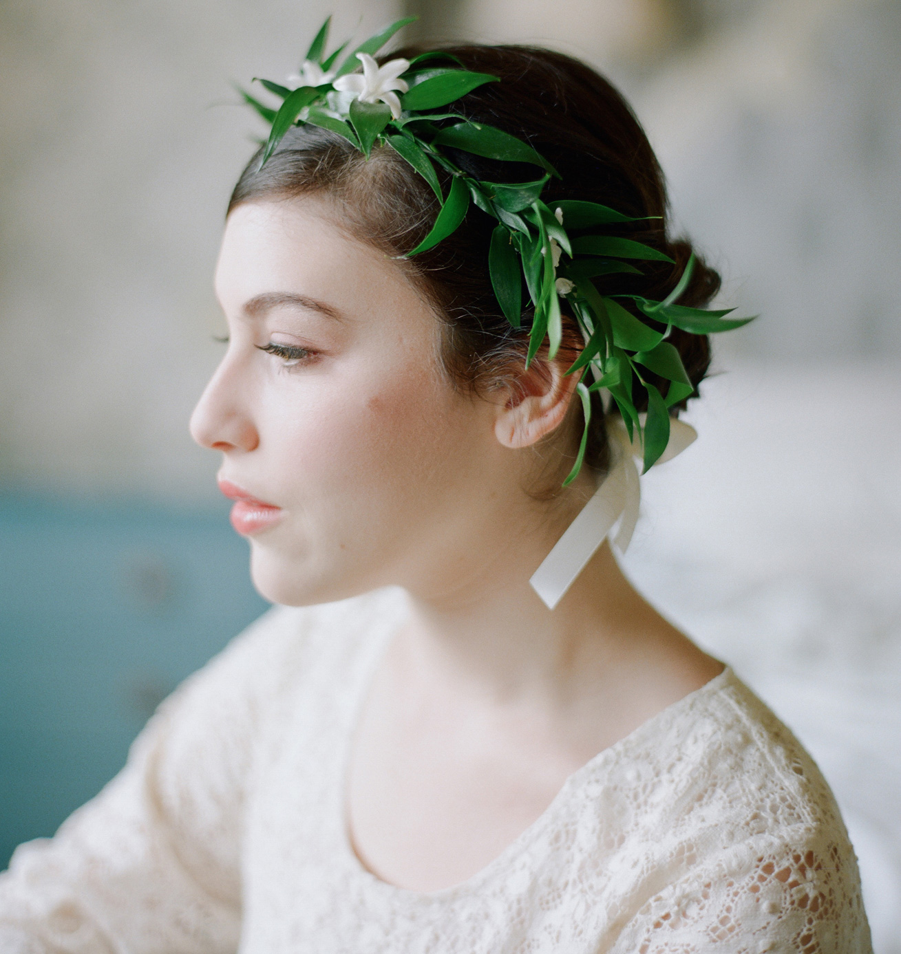 Bridesmaid wearing greenery and flower crown