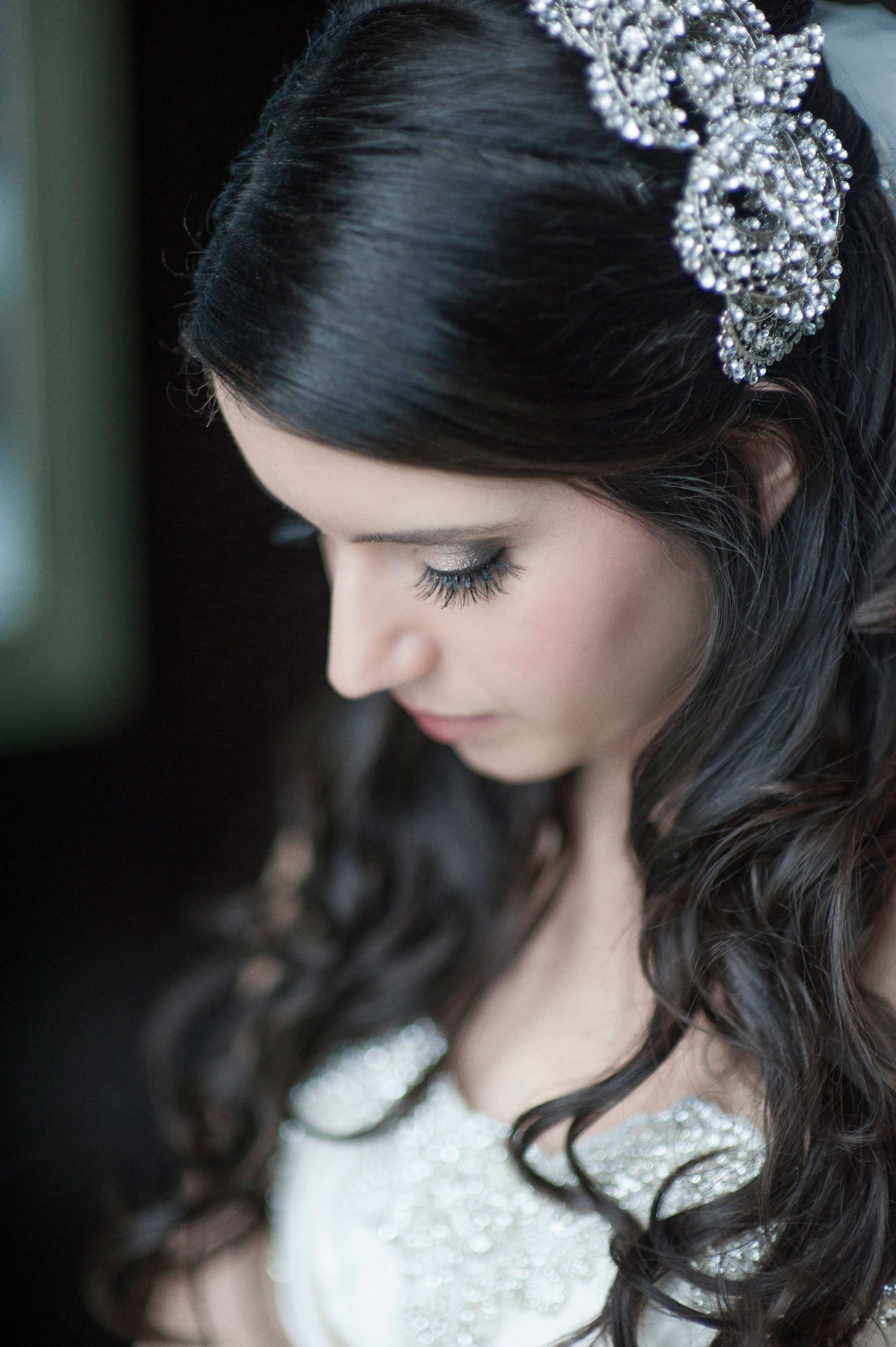 Bride in jewel ball gown with crystal hair accessory