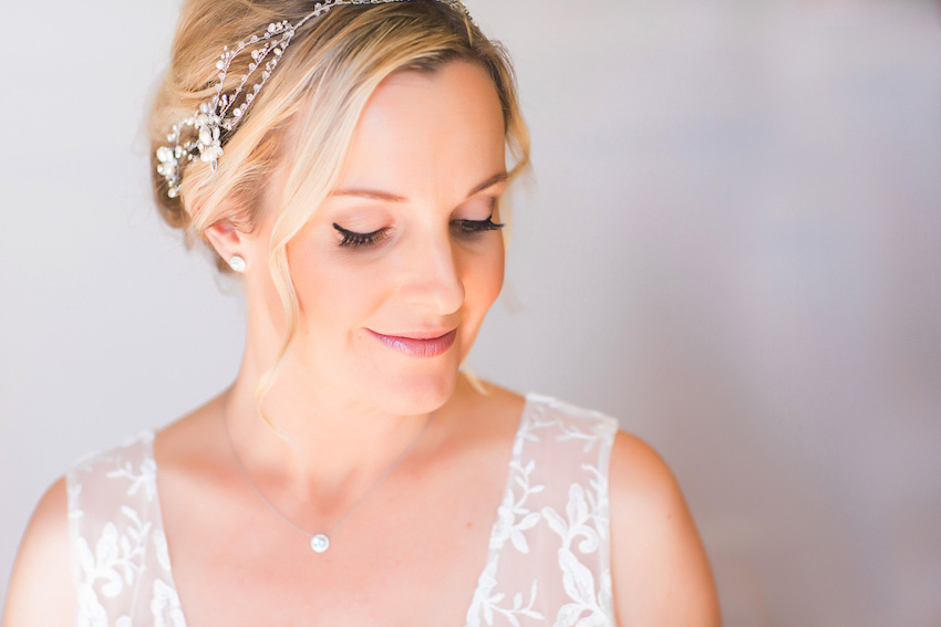 Bride in Claire Pettibone dress with crystal headband