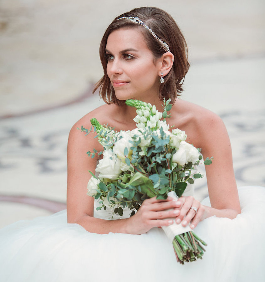Bride holding rustic bouquet with crystal headband