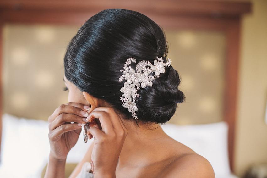 Crystal hair accessory on bride's bun updo