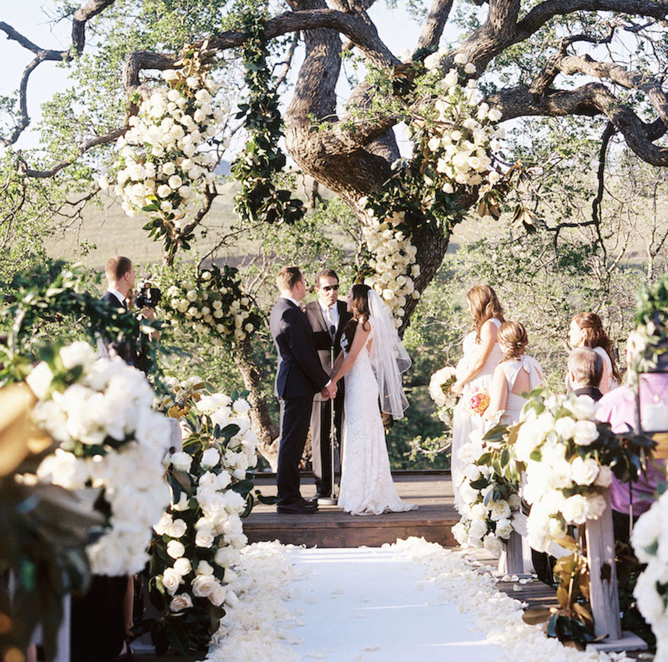 Bride and groom ceremony under oak tree