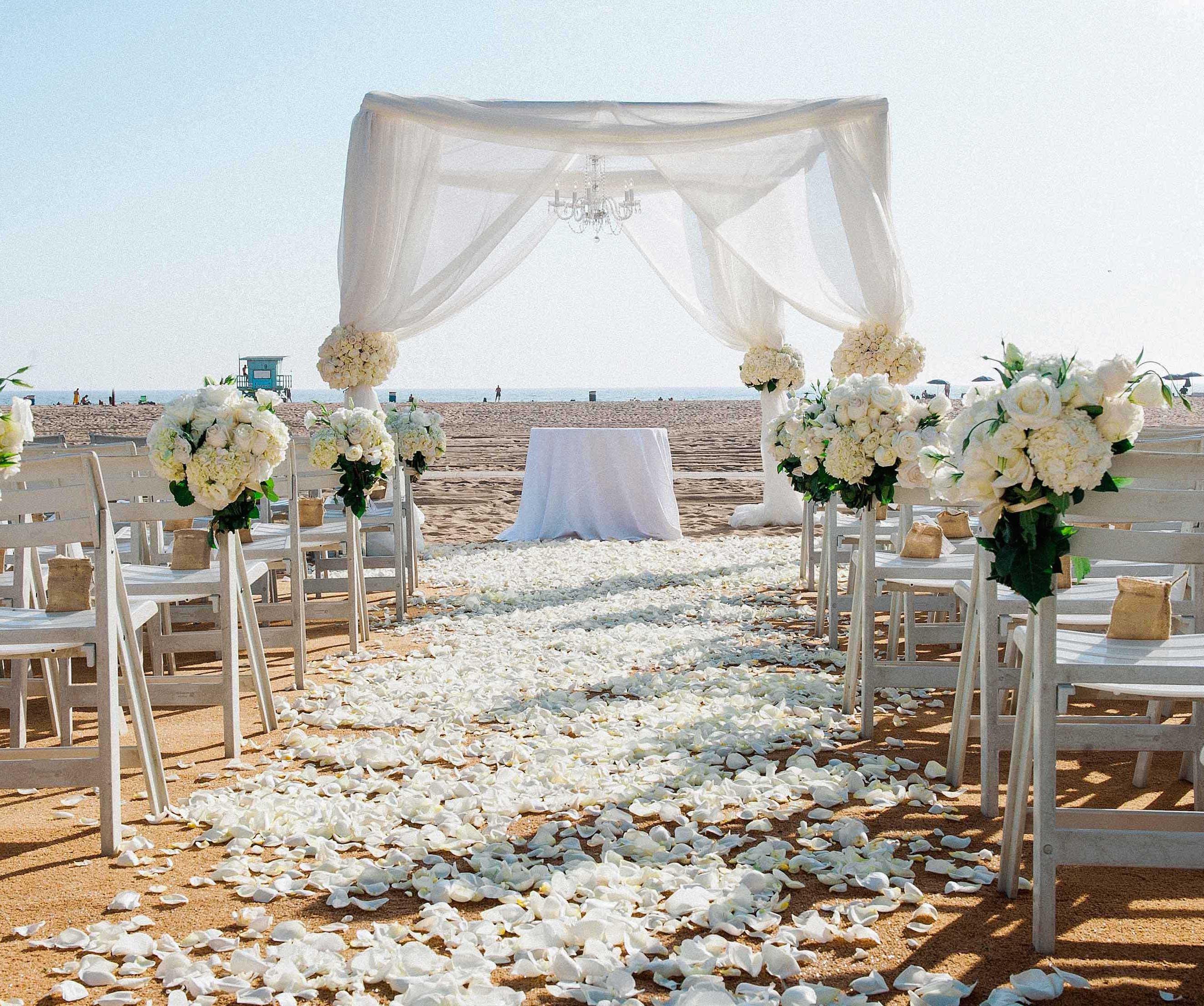 White beach wedding ceremony