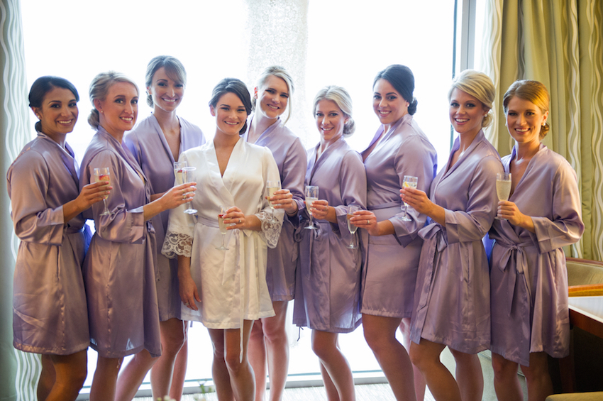 Bridesmaids in silk purple robes