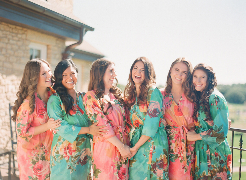 Bridesmaids laughing in flower print robes