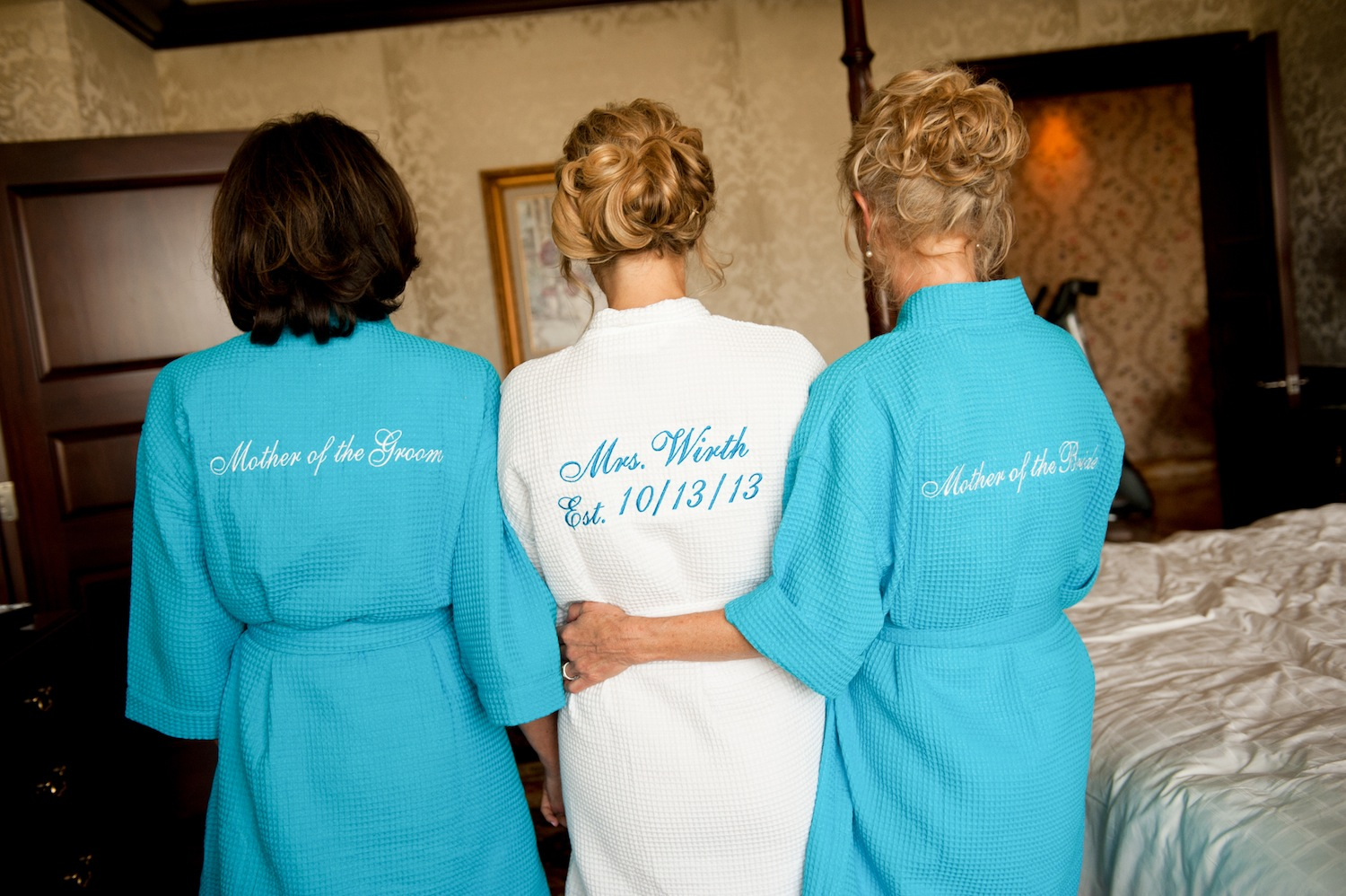 Bride and mother of the bride with robes