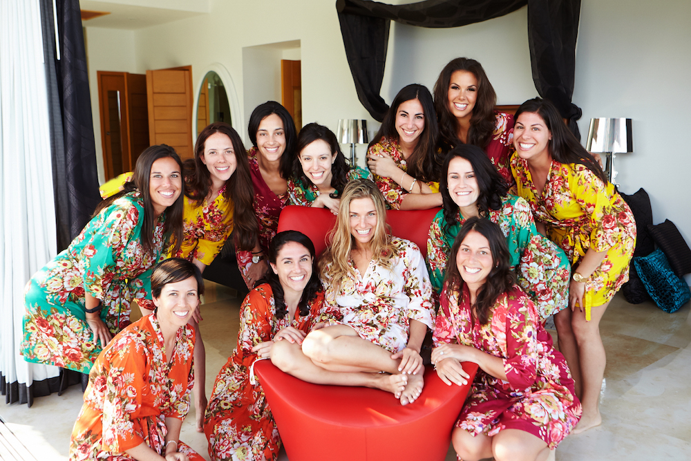 Destination wedding bridesmaids in flower print robes