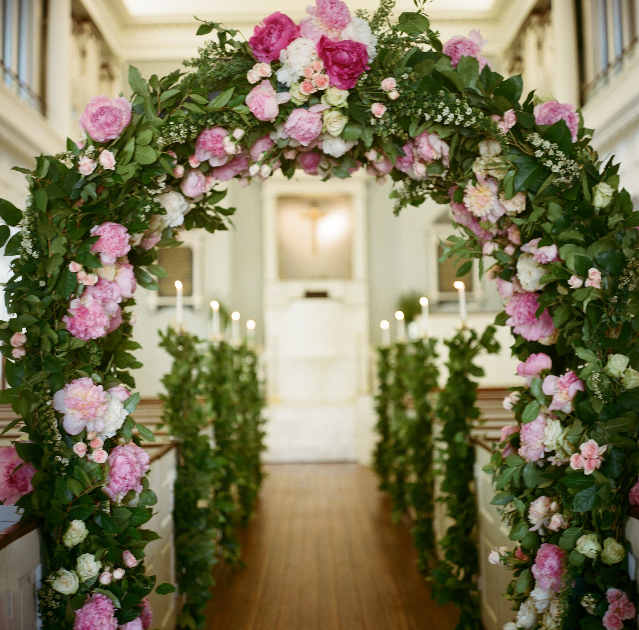 Pink flower and greenery wedding arches