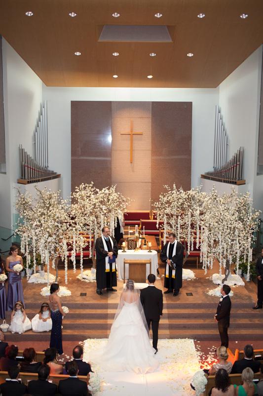 White tree decor at church ceremony