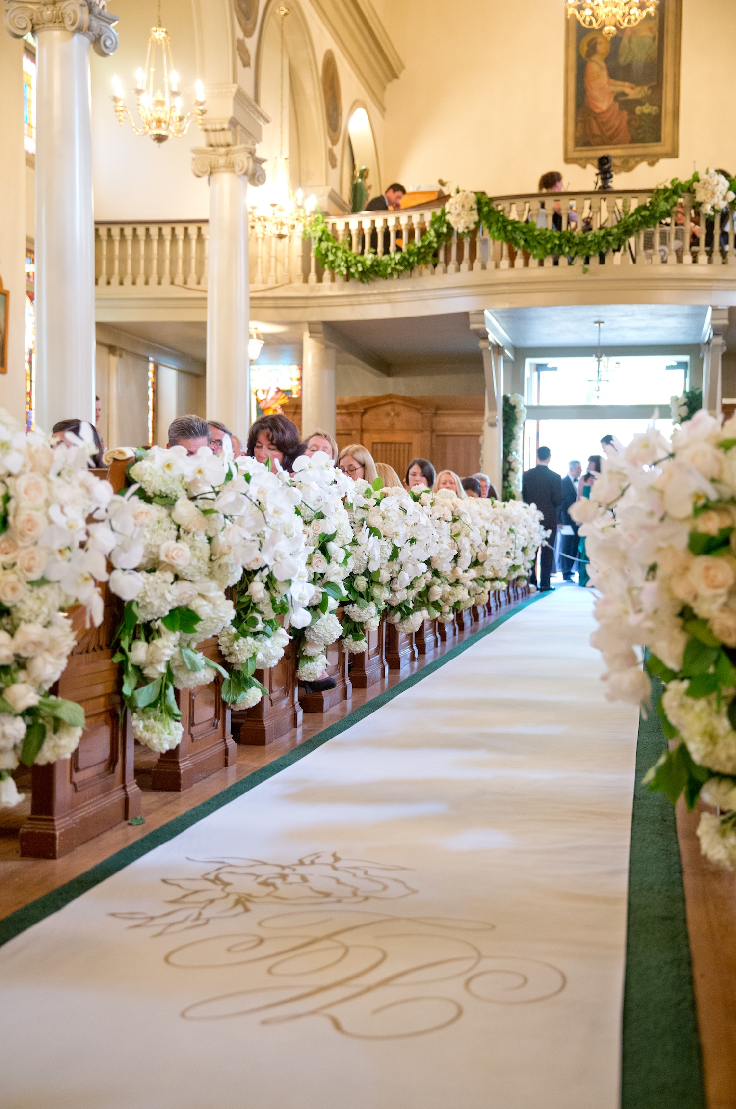 Custom aisle runner and flowers at church wedding