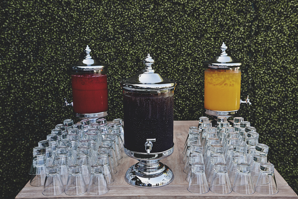 Colorful drink dispensers filled with juice