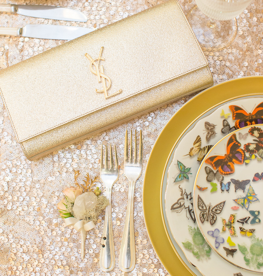 Gold YSL wedding clutch on table