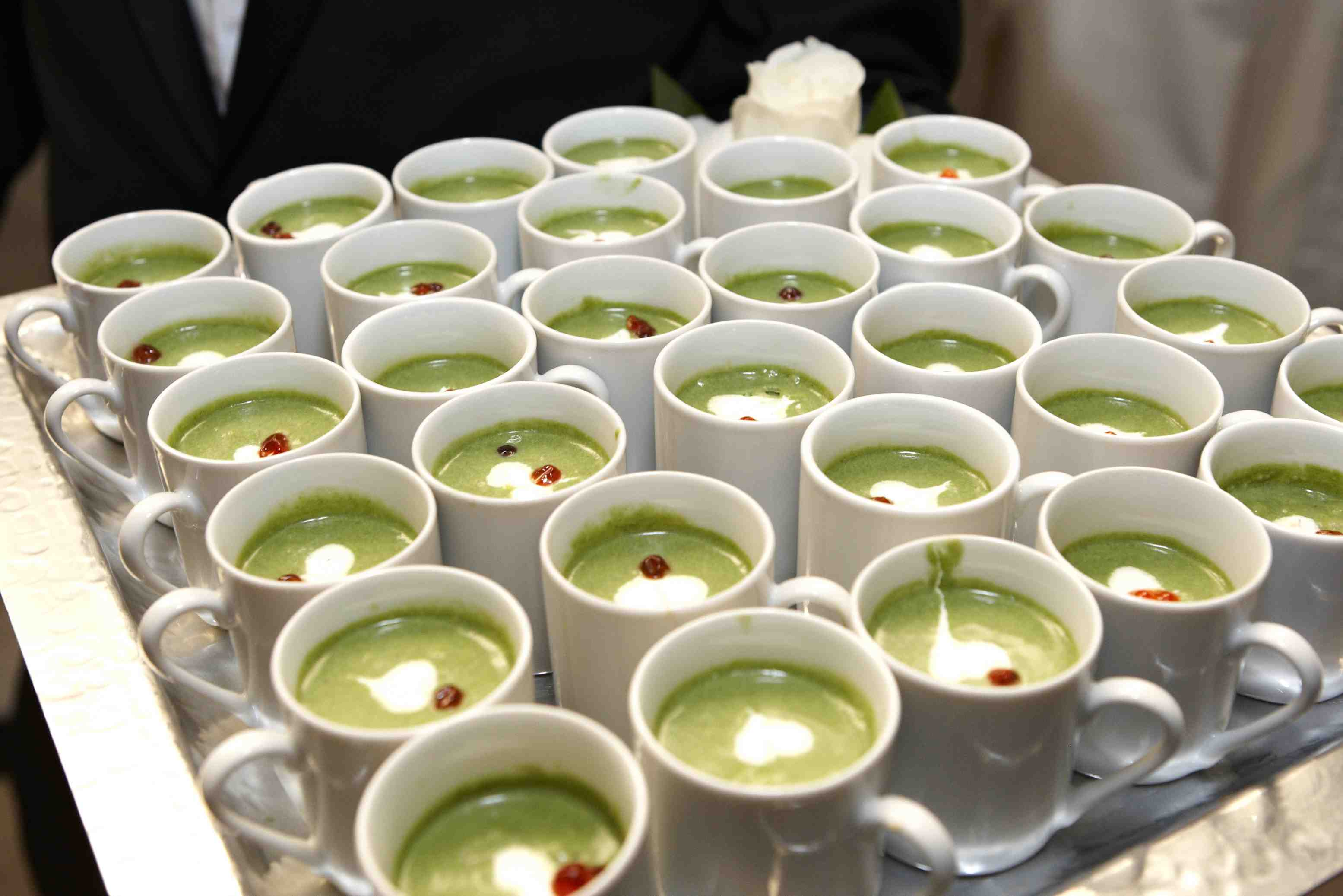 Mugs filled with light green soup