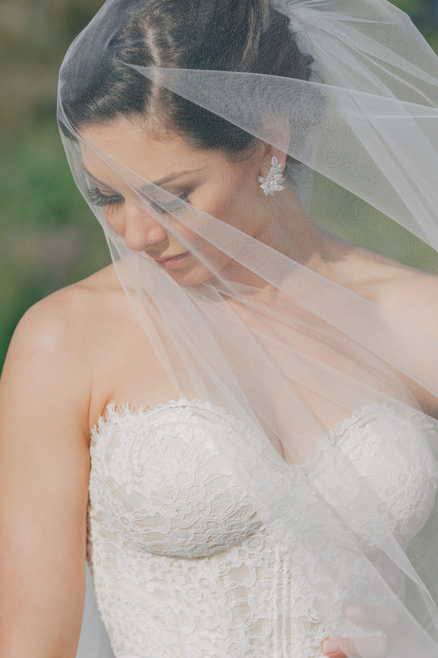 Nick Carter bride behind wedding veil