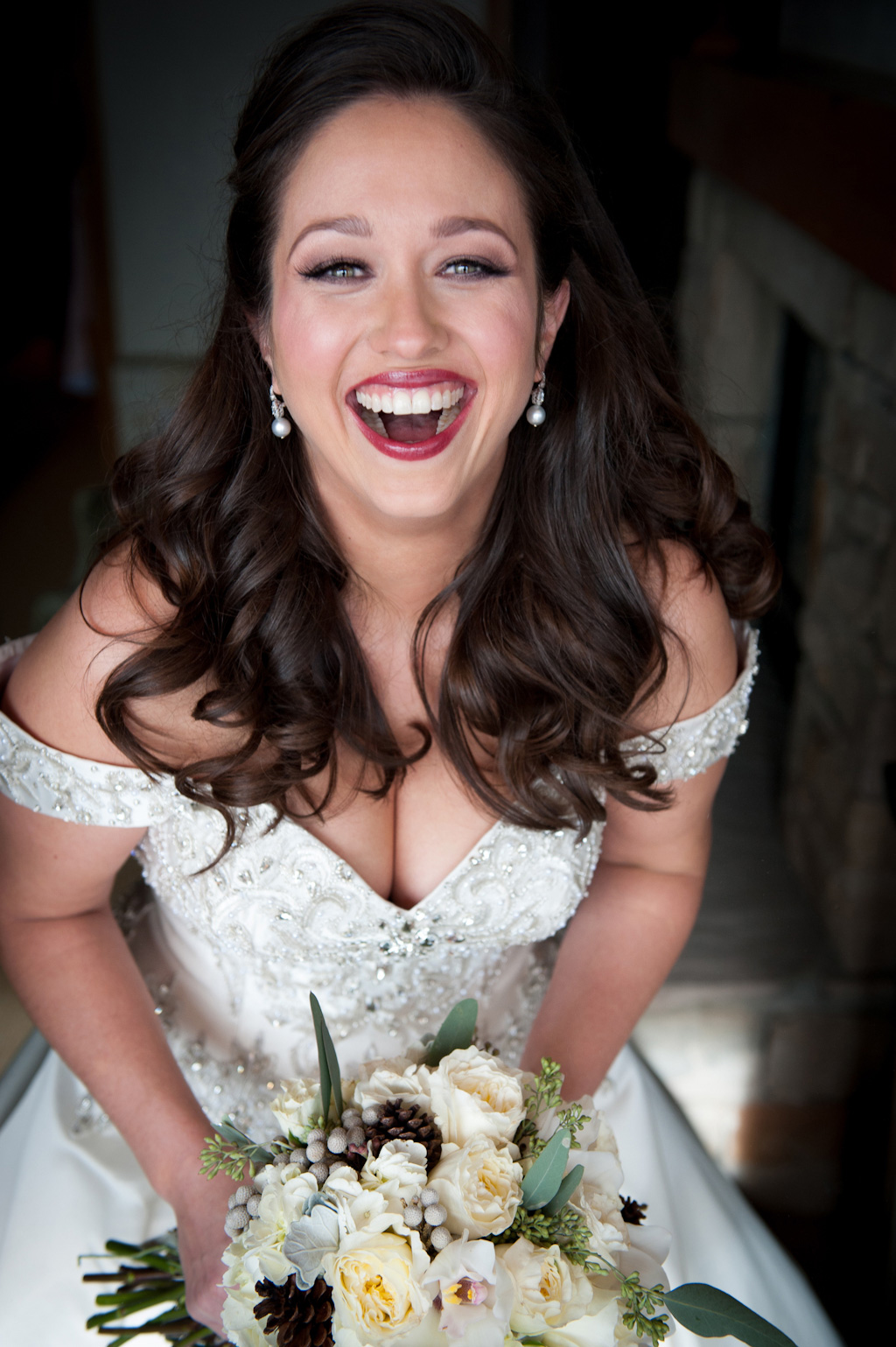 Winter bride smiling with red lipstick