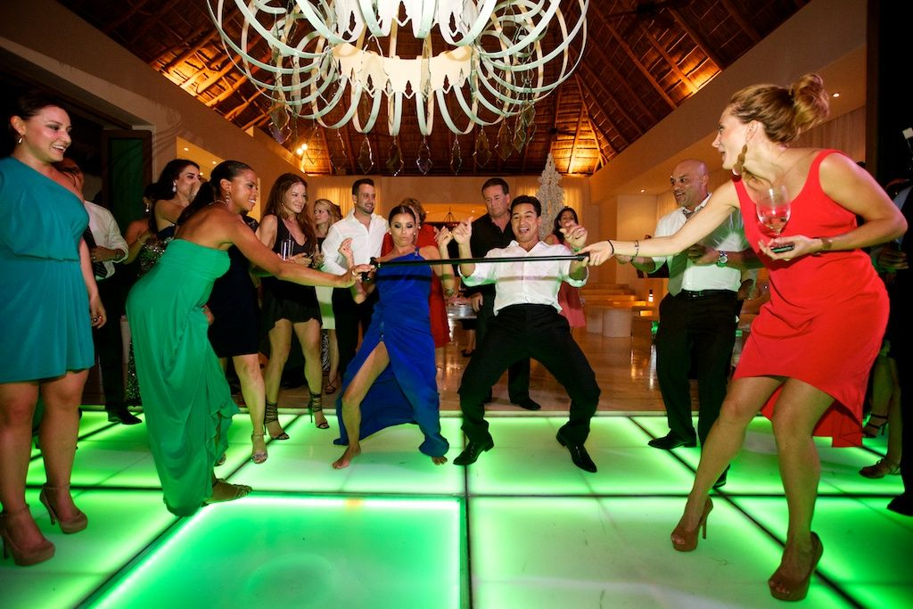 Eva Longoria and Mario Lopez doing the limbo at Mario's wedding reception