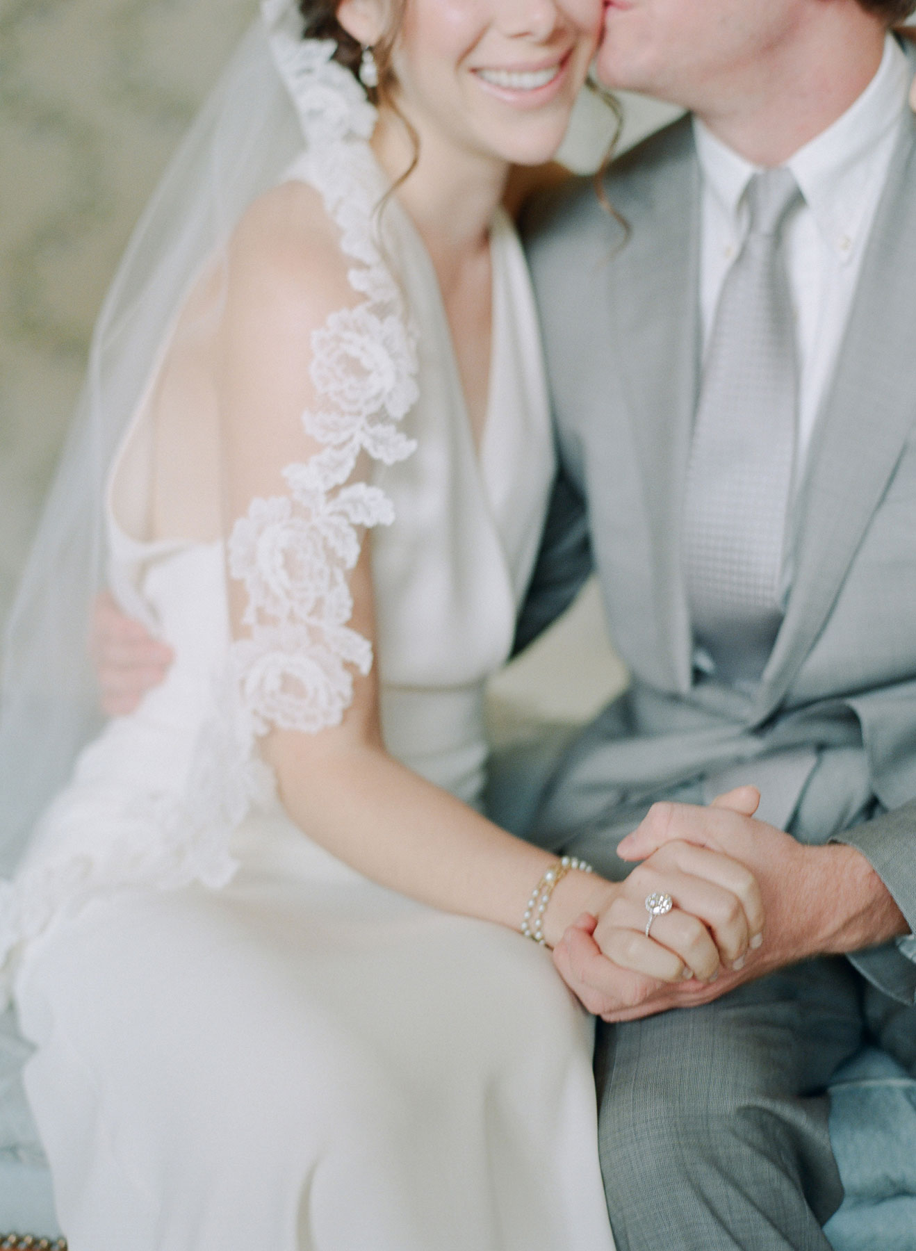 Groom wearing grey suit and tie on wedding day