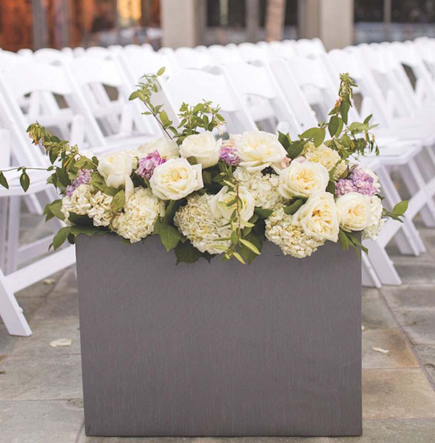 Grey flower box at outdoor wedding ceremony