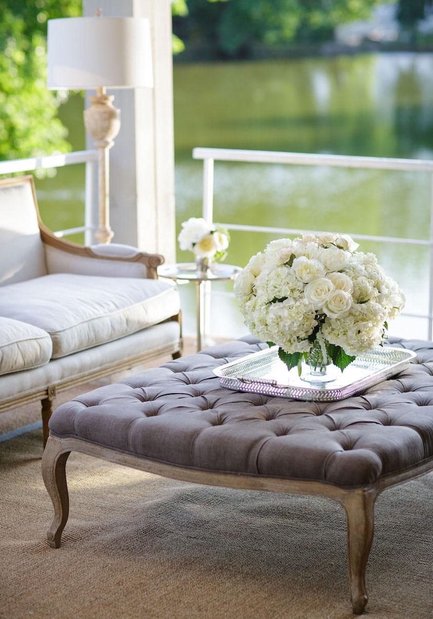 Dark grey tufted ottoman at wedding lounge
