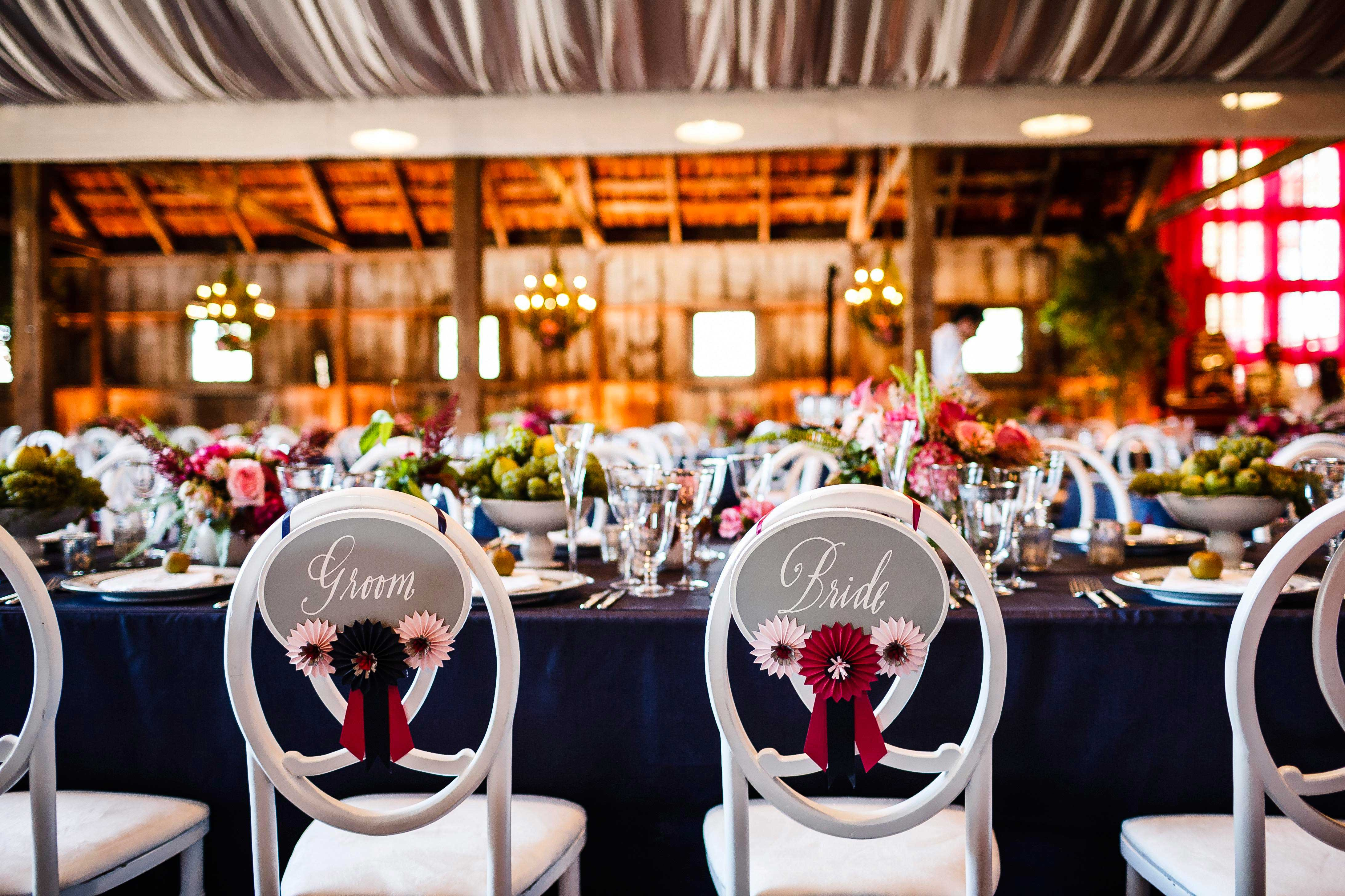 Grey bride and groom chair signs