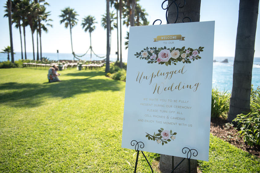 Sign asking guests not to use their phone or take photos during the wedding ceremony