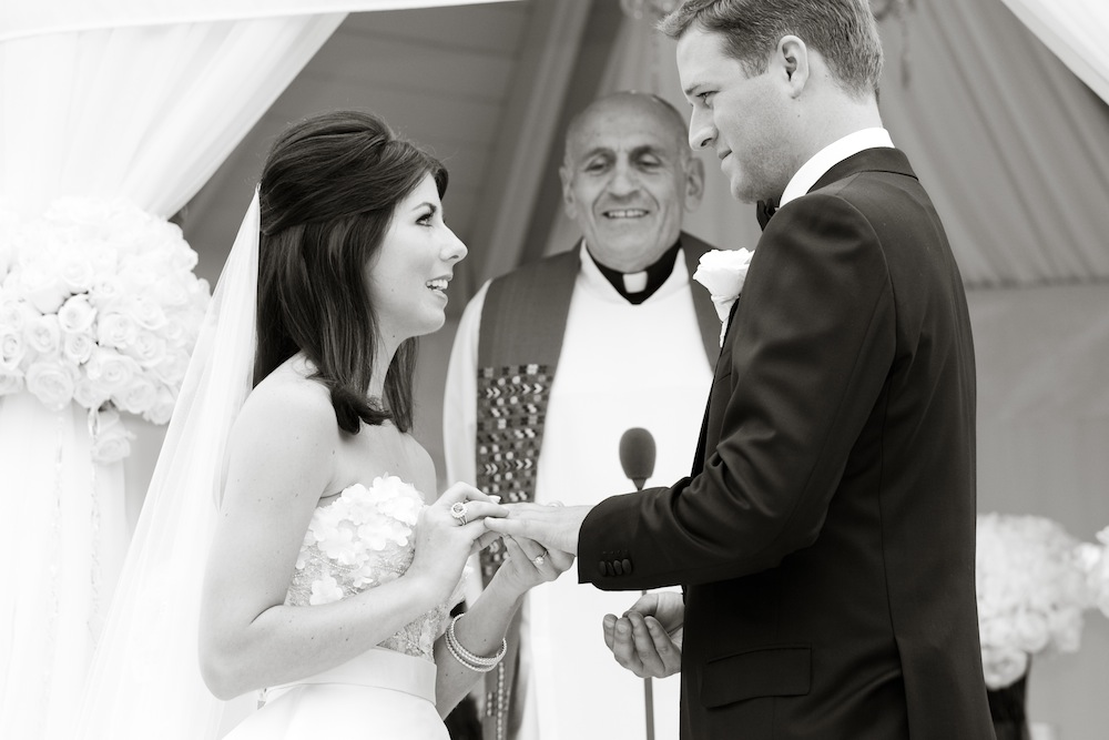 Black and white photo of bride and groom's wedding vows