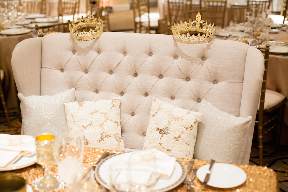 Tufted high back bench with crowns at wedding