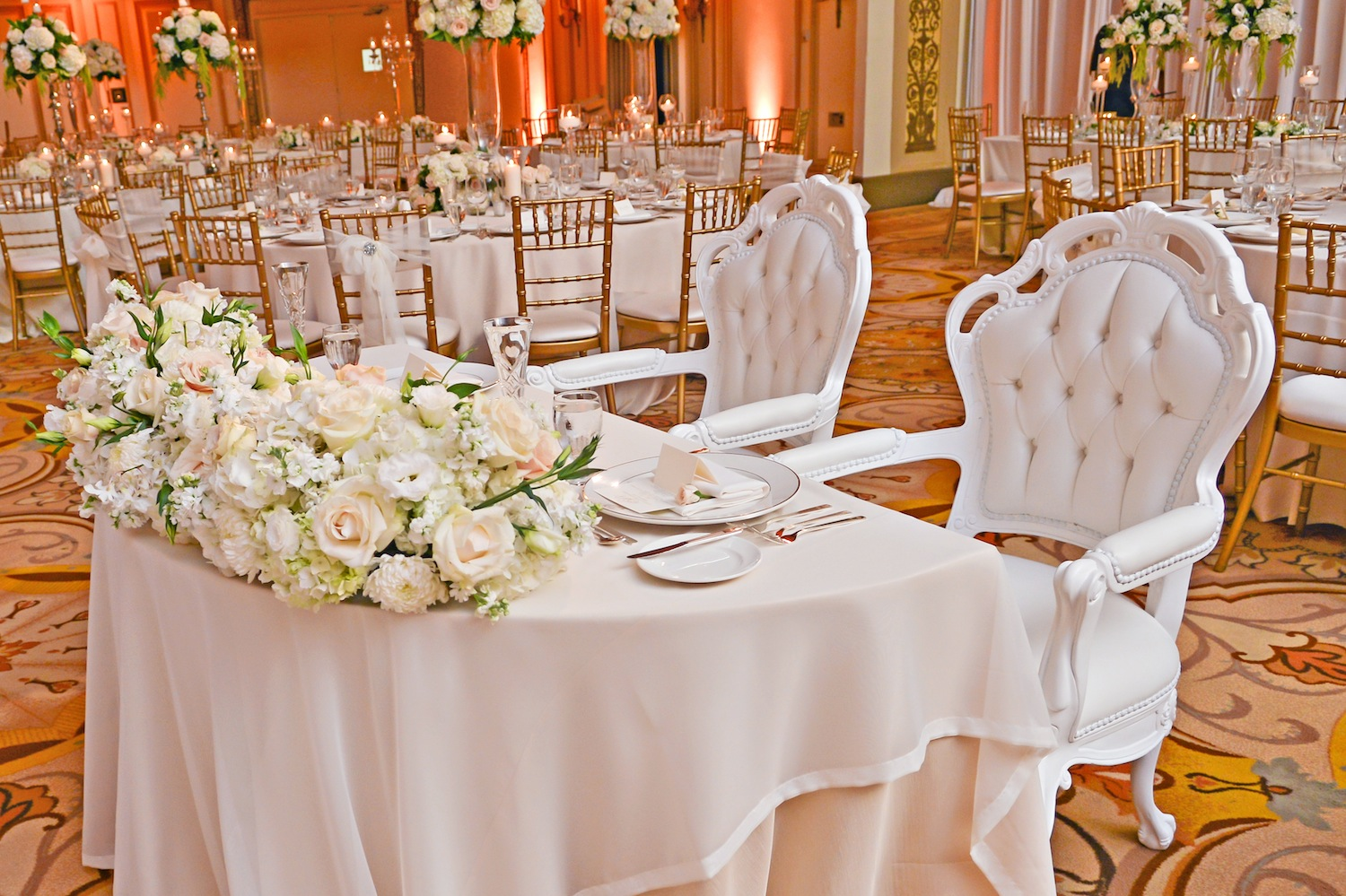 Tufted arm chair at sweetheart table
