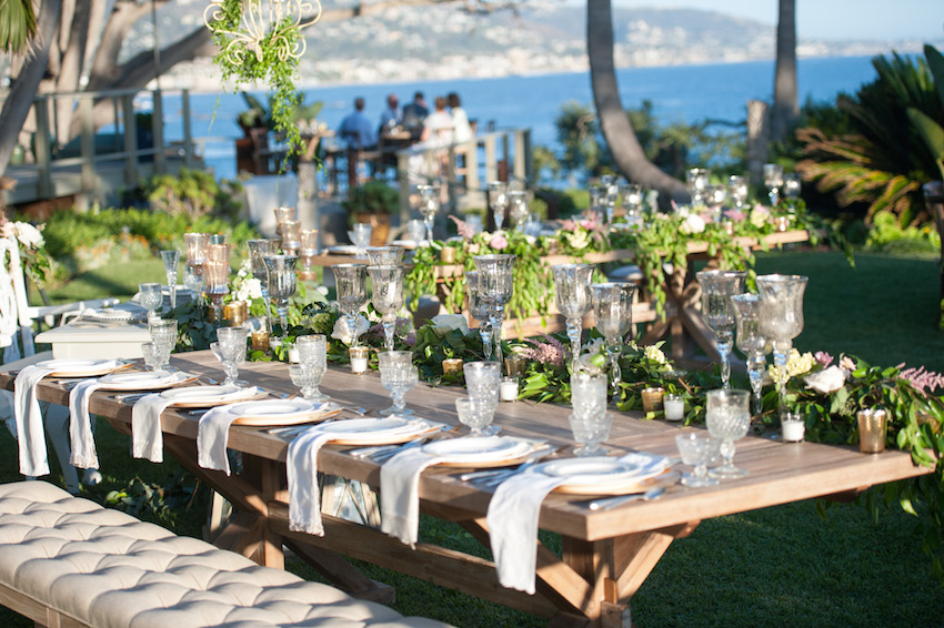 Tufted bench at outdoor wedding reception