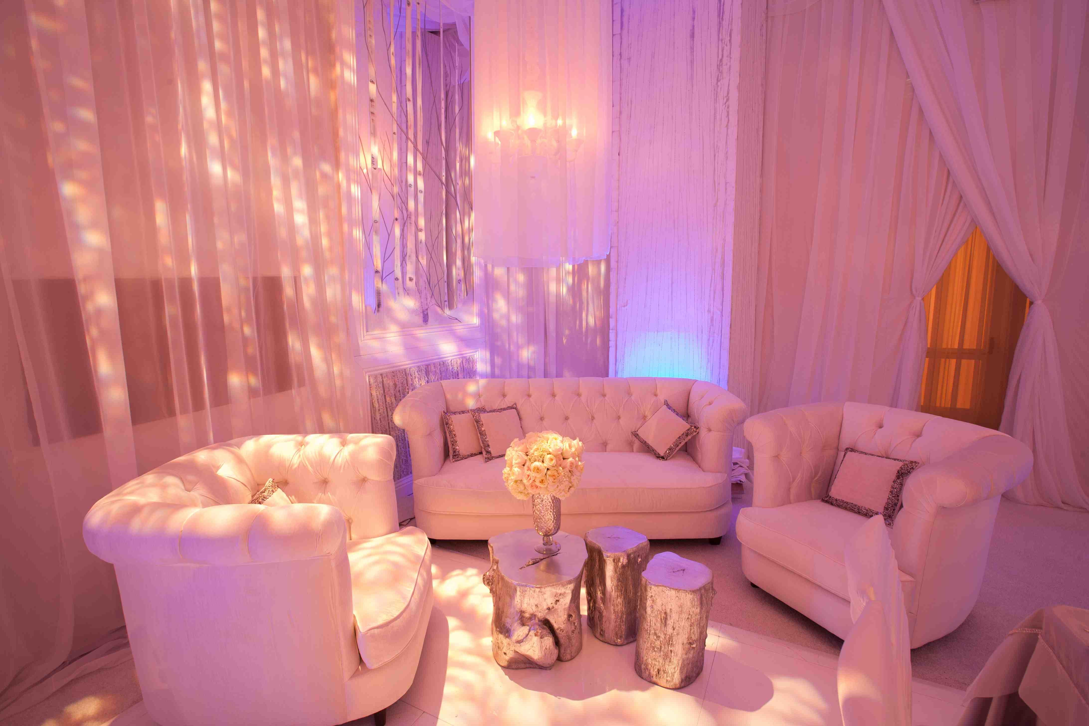 Purple lighting at tufted lounge area