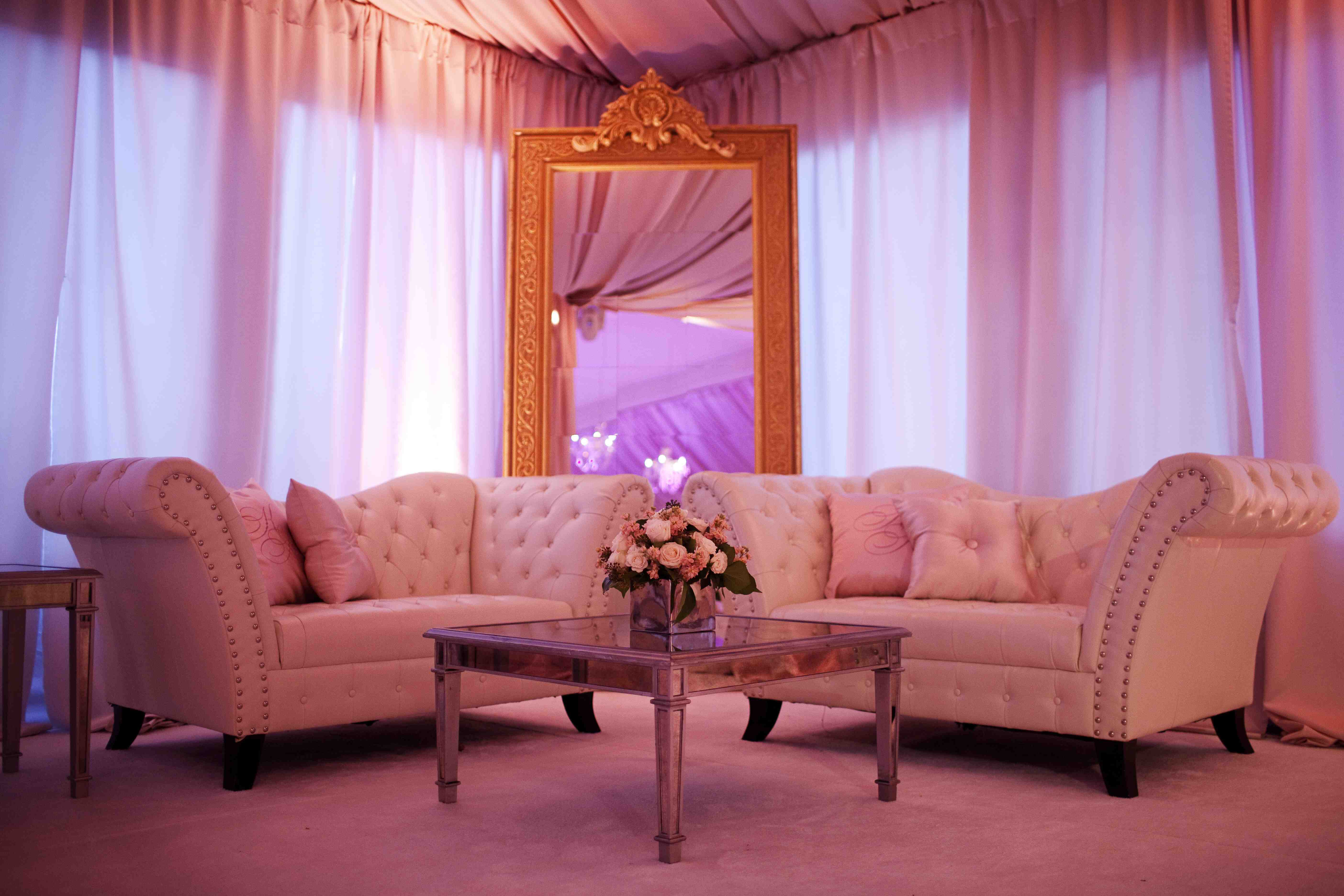 Tufted sofas at wedding lounge