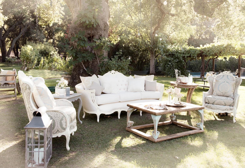 White tufted sofa on wedding lawn
