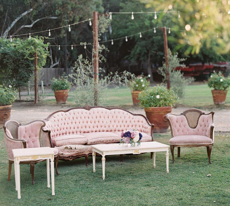 Pink tufted lounge furniture on wedding lawn